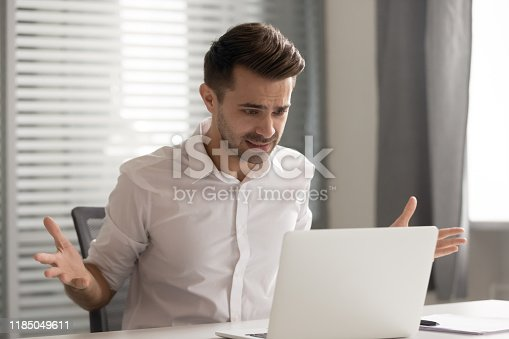 502723248 istock photo Angry stressed business man annoyed by computer problem in office 1185049611