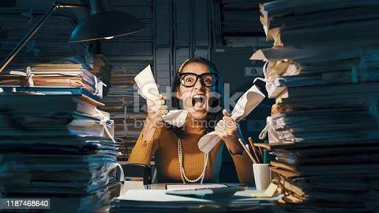187928332istockphoto Angry stressed office worker overloaded with paperwork 1187468640