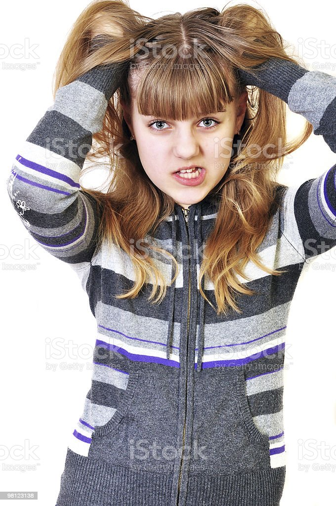angry teen disarranging her hair royalty-free stock photo