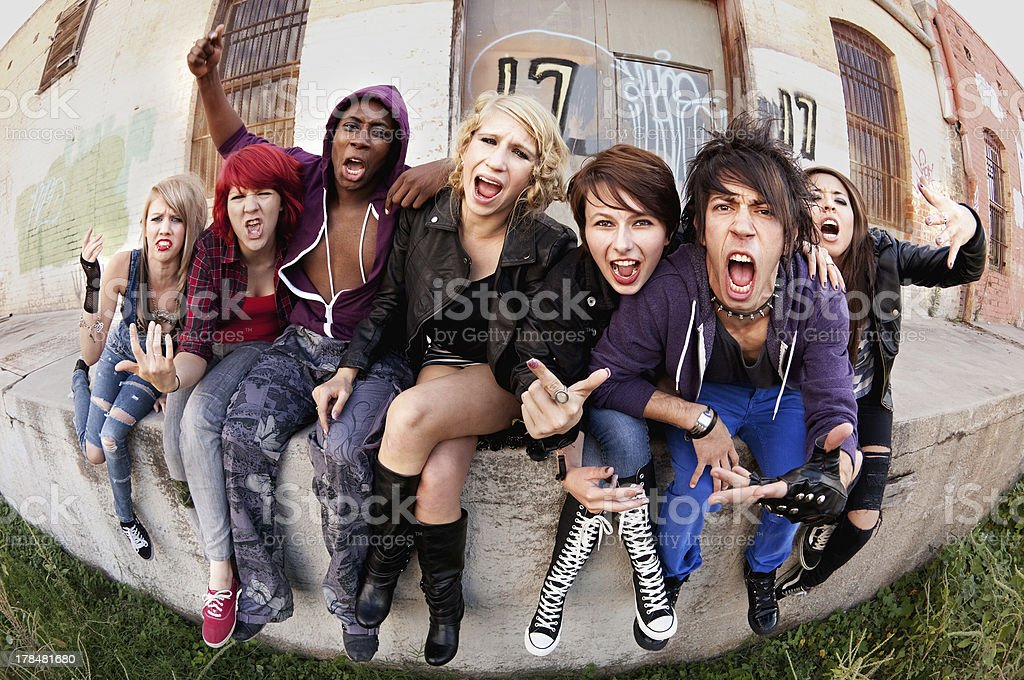 Angry teen punks shout towards the camera stock photo