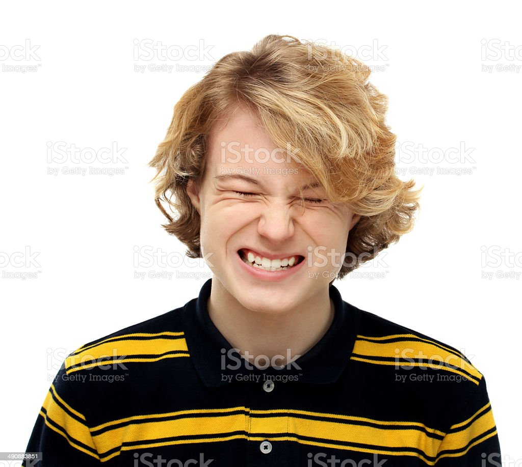 .Angry teenage boy grinding teeth in extreme rage royalty-free stock photo