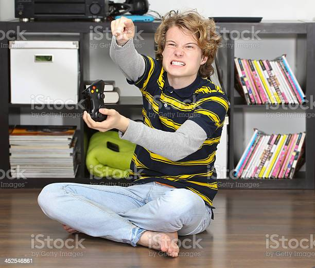 Angry Teenage Boy Playing Game Stock Photo - Download Image Now