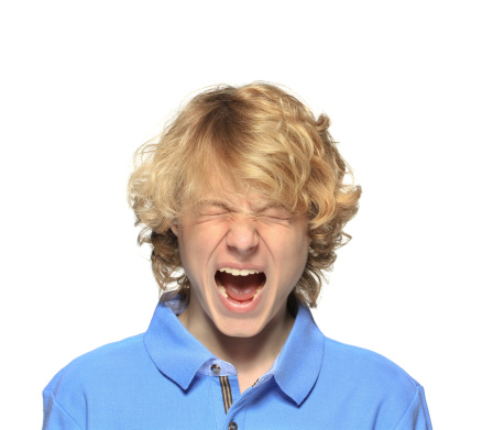 Angry Teenage Boy Screaming In Extreme Rage Stock Photo ...