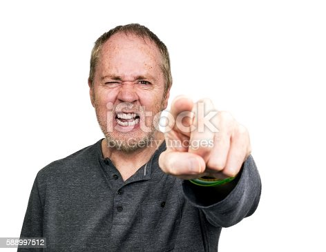 istock Angry threatening man pointing and shouting. 588997512