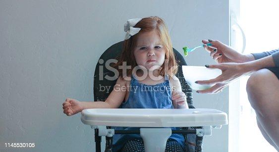 Angry toddler hates broccoli