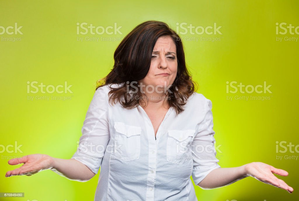 angry unhappy middle aged woman with arms out asking what's the problem stock photo