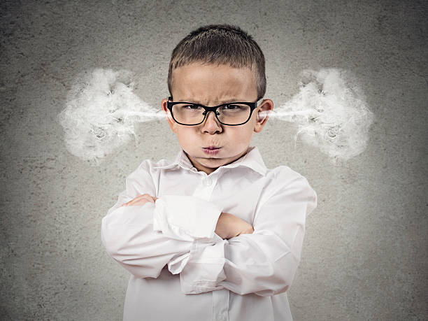 Angry upset boy, little man stock photo