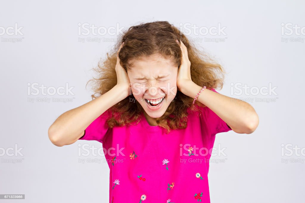angry upset, stressed little young girl, having nervous breakdown, screaming stock photo