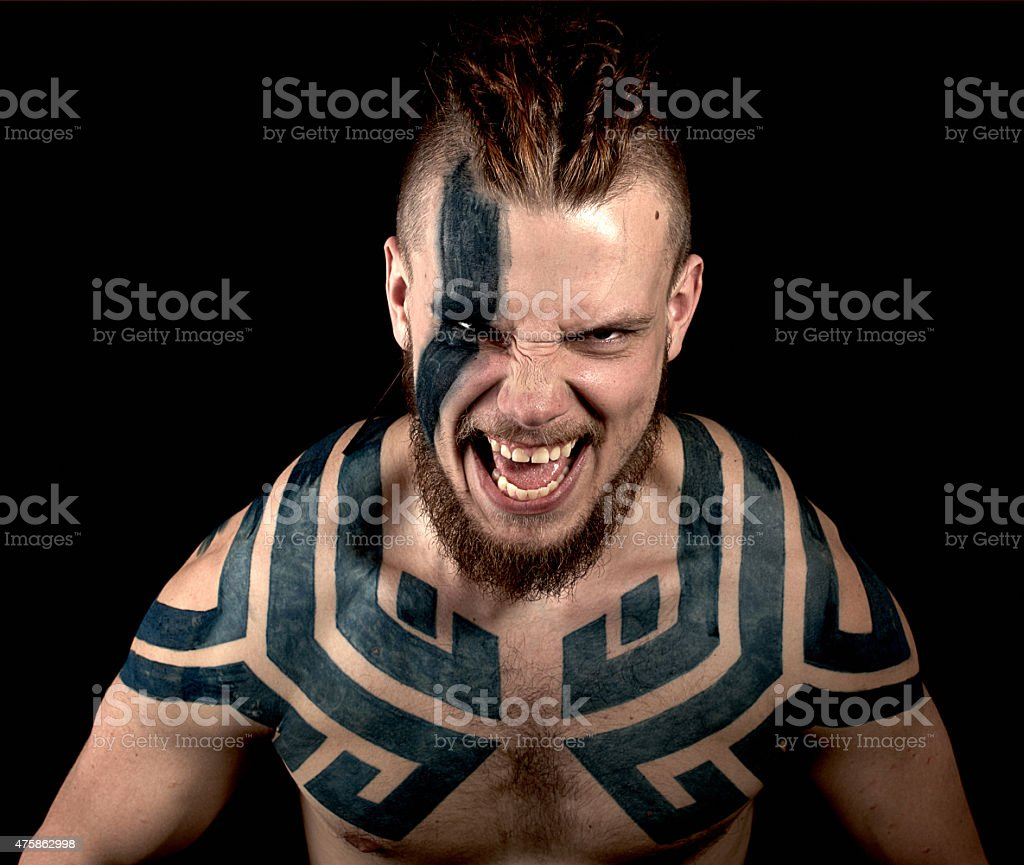 Angry viking with tattoos stock photo