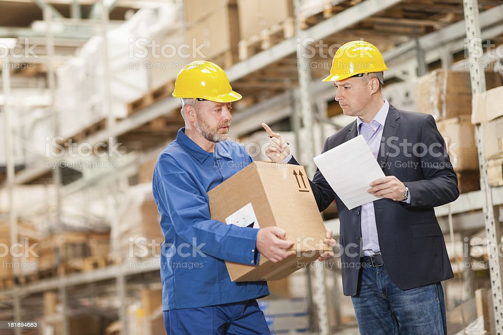 Angry warehouse manager royalty-free stock photo