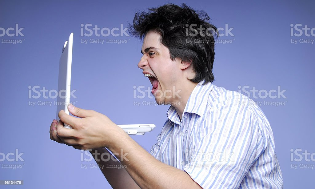 A angry white male yelling at laptop royalty-free stock photo
