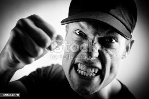 istock Angry white man punching 155441878