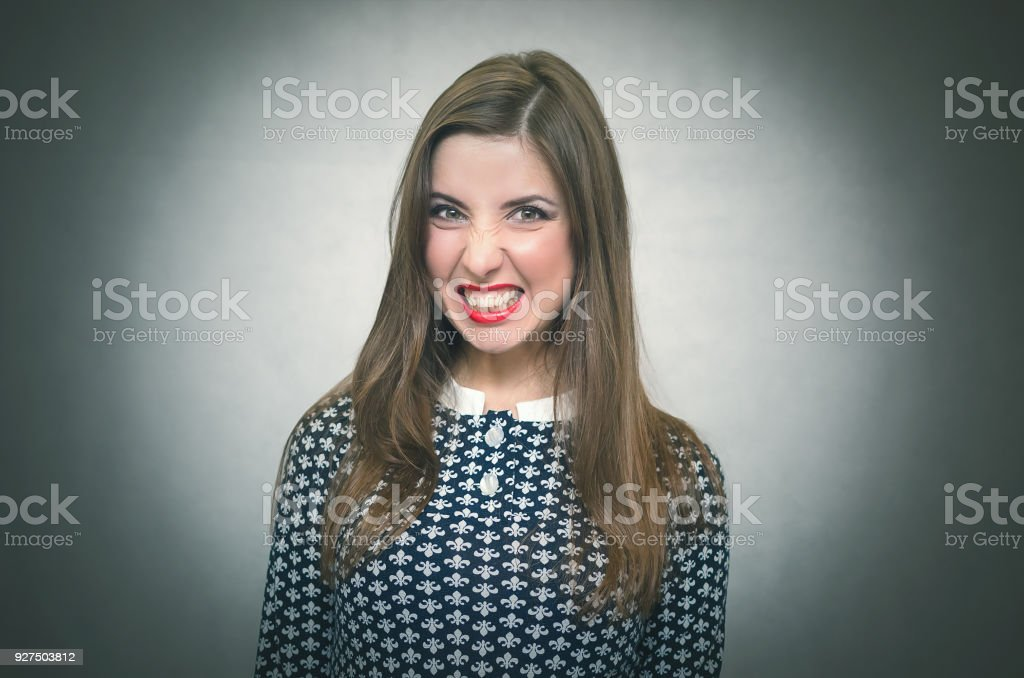 Angry wicked girl. Woman shouting. stock photo