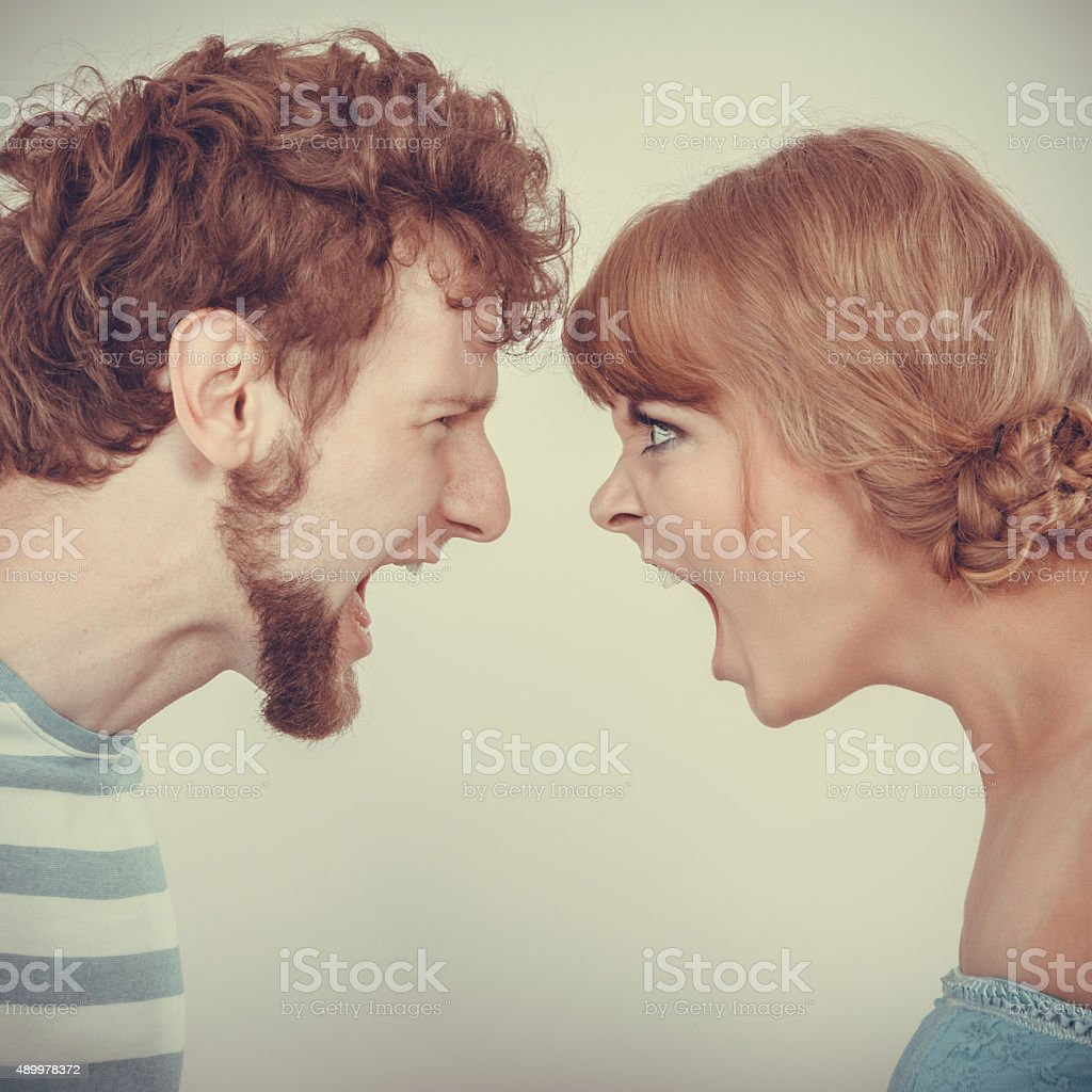 Angry woman and man yelling at each other. stock photo