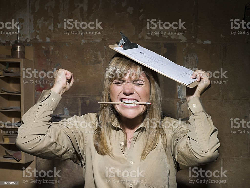 Angry woman biting a pencil royalty-free 스톡 사진