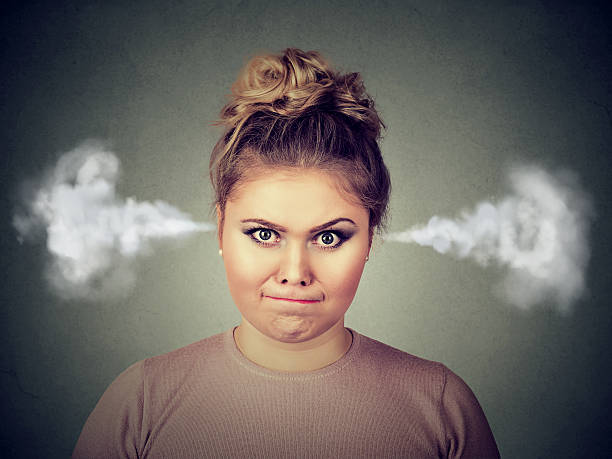 angry woman, blowing steam coming out of ears - funny fat lady stock photos and pictures
