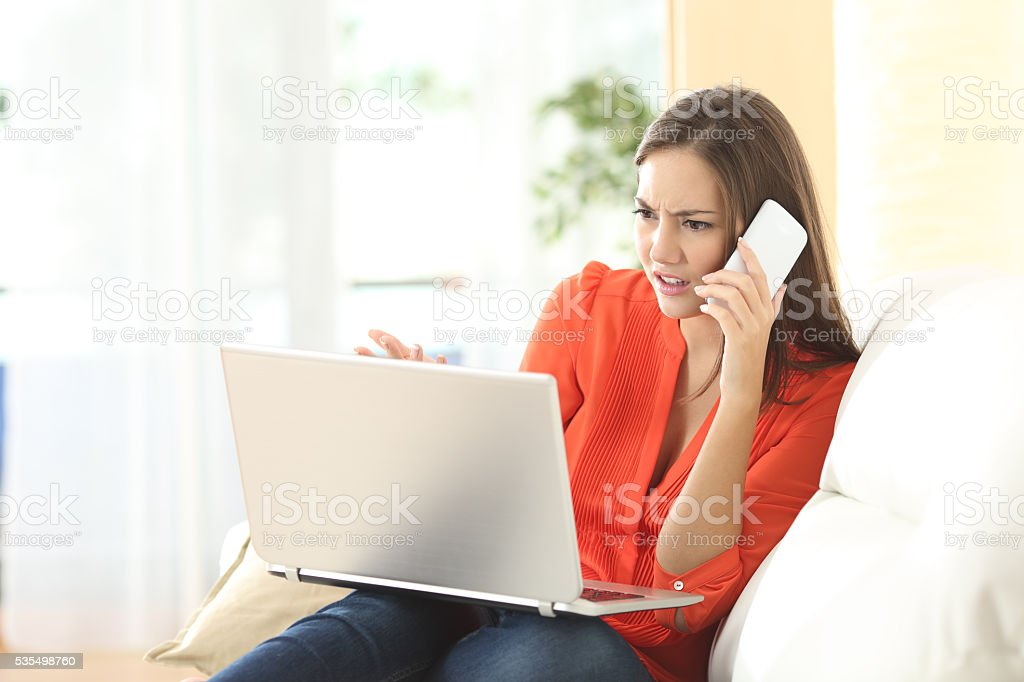 Angry woman calling custom service stock photo