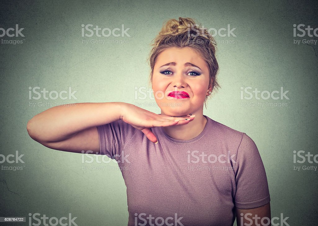angry woman gesturing with hand to stop talking stock photo