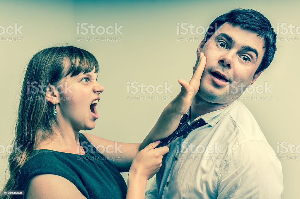 Angry woman giving a slap - domestic violence concept stock photo