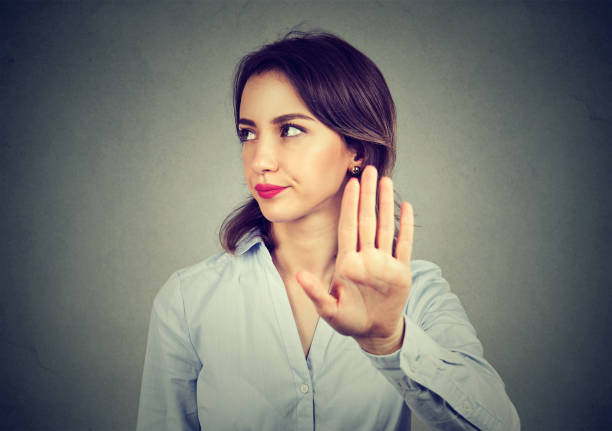 angry woman giving talk to hand gesture - frowning stock photos and pictures