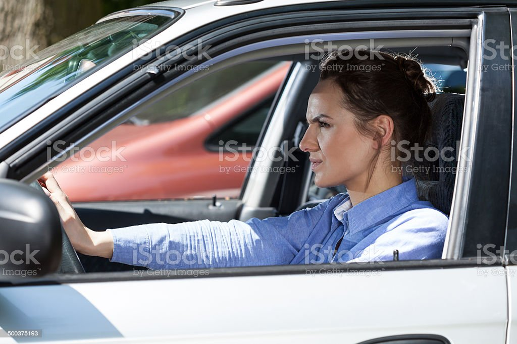 Angry woman in a traffic jam stock photo