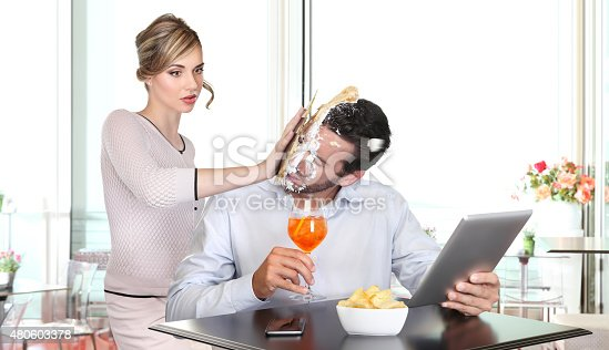istock angry woman pulling cake in face to boyfriend cheating 480603378