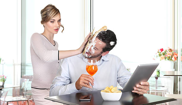angry woman pulling cake in face to boyfriend cheating - delude stock pictures, royalty-free photos & images