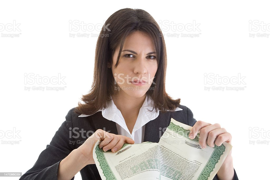 Angry Woman Ripping a Stock Certificate royalty-free stock photo