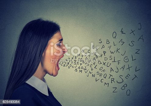 istock angry woman screaming alphabet letters flying out of mouth 625493054