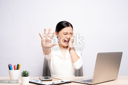 1138361116 istock photo Angry woman screaming at office isolated over background 1159763331
