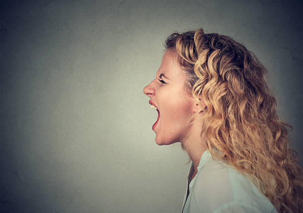 Angry woman screaming stock photo