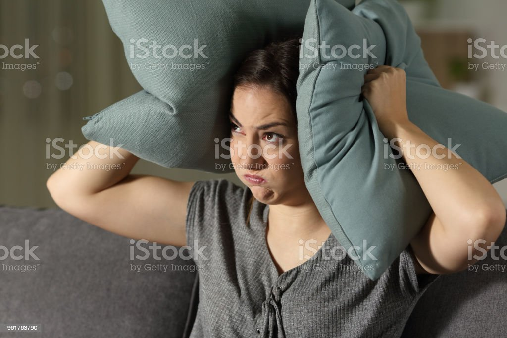 Angry woman suffering neighbour noise stock photo