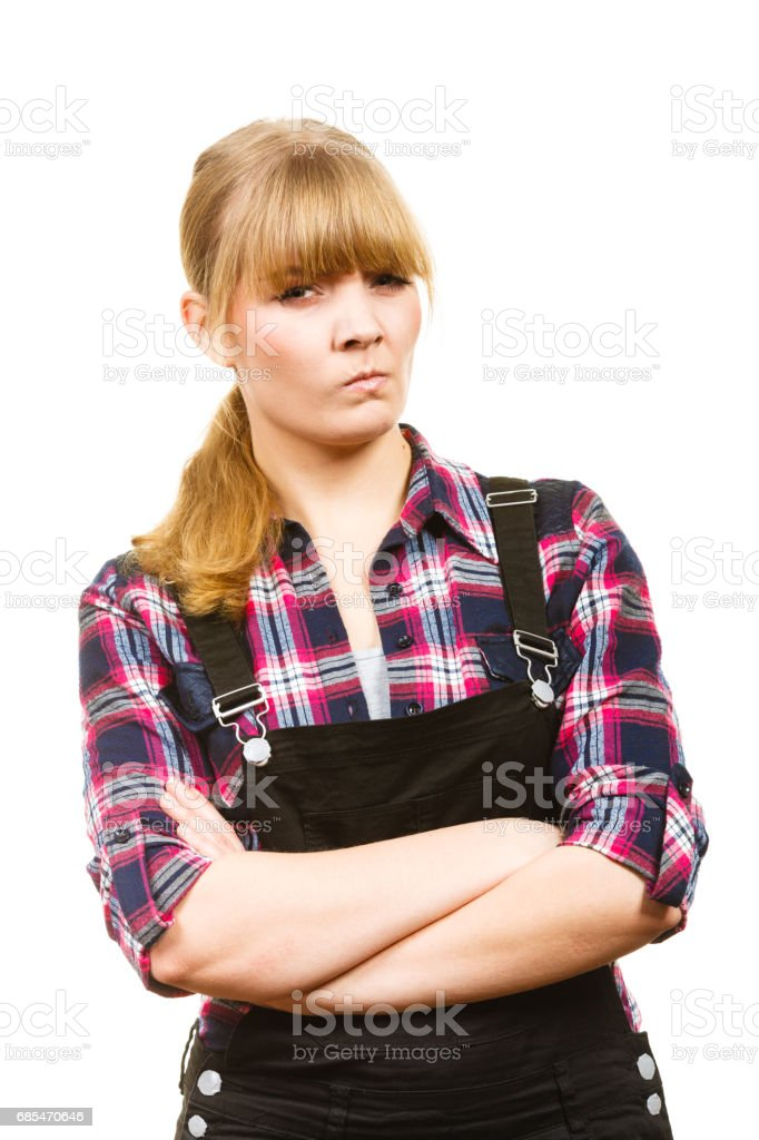Angry woman wearing dungarees and check shirt foto de stock royalty-free