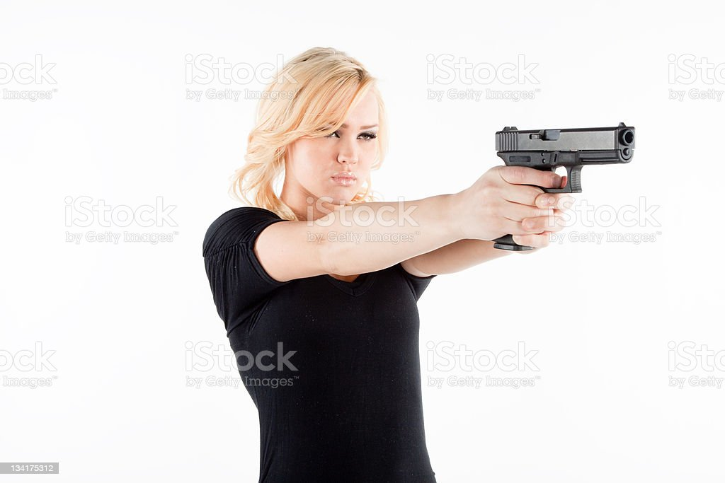 Angry woman with a gun stock photo