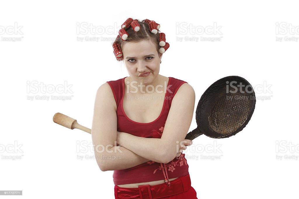 Angry woman with curlers in her hair. stock photo