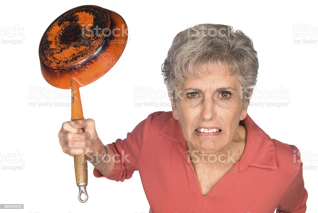 Angry woman with frying pan royalty-free stock photo