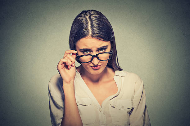 angry woman with glasses skeptically looking at you - judgement stock pictures, royalty-free photos & images