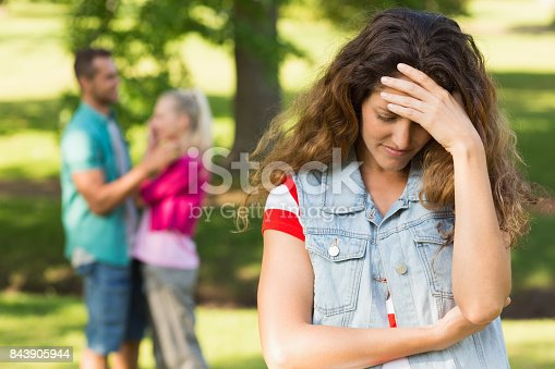 istock Angry woman with man and girlfriend in background at park 843905944