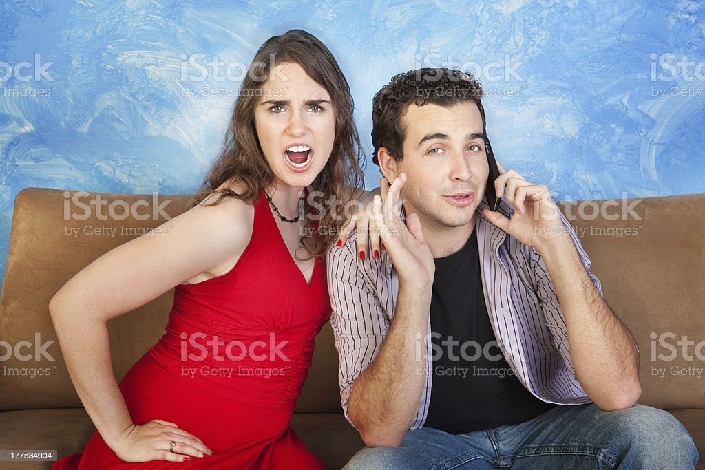 Angry Woman with Man on Phone royalty-free stock photo