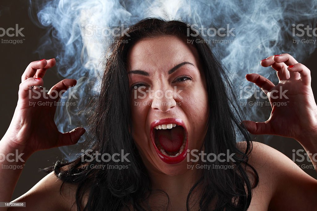 Angry woman with smoke royalty-free stock photo