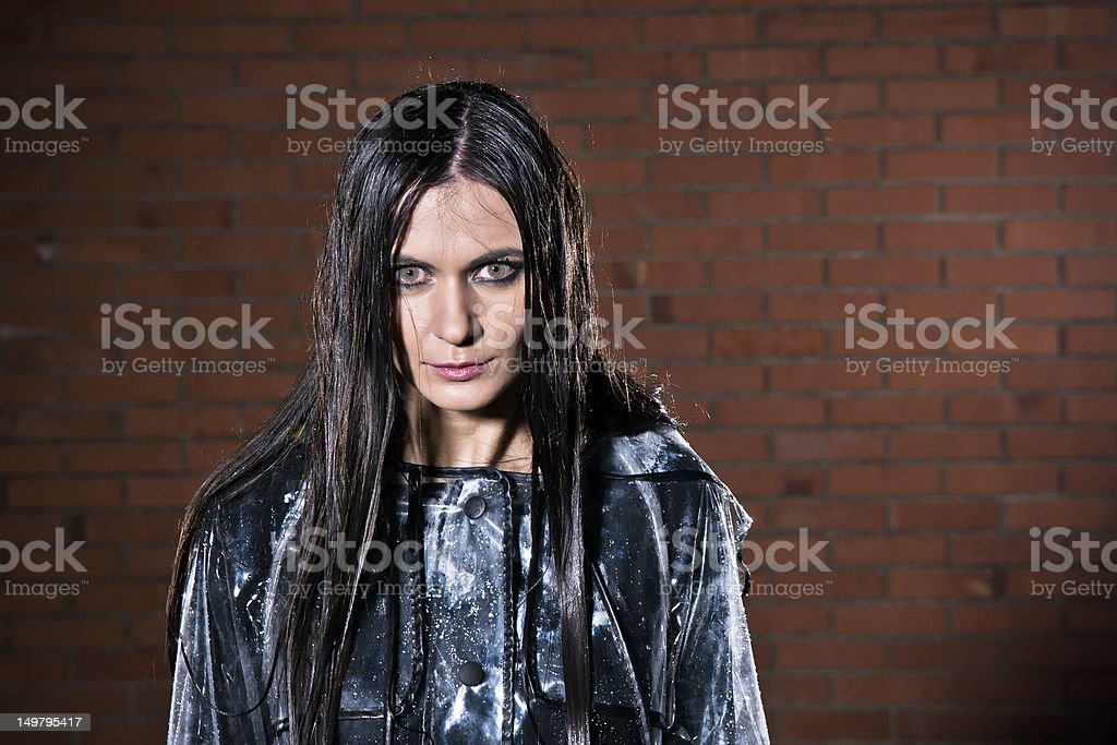 Angry woman with wet hair after the rain stock photo