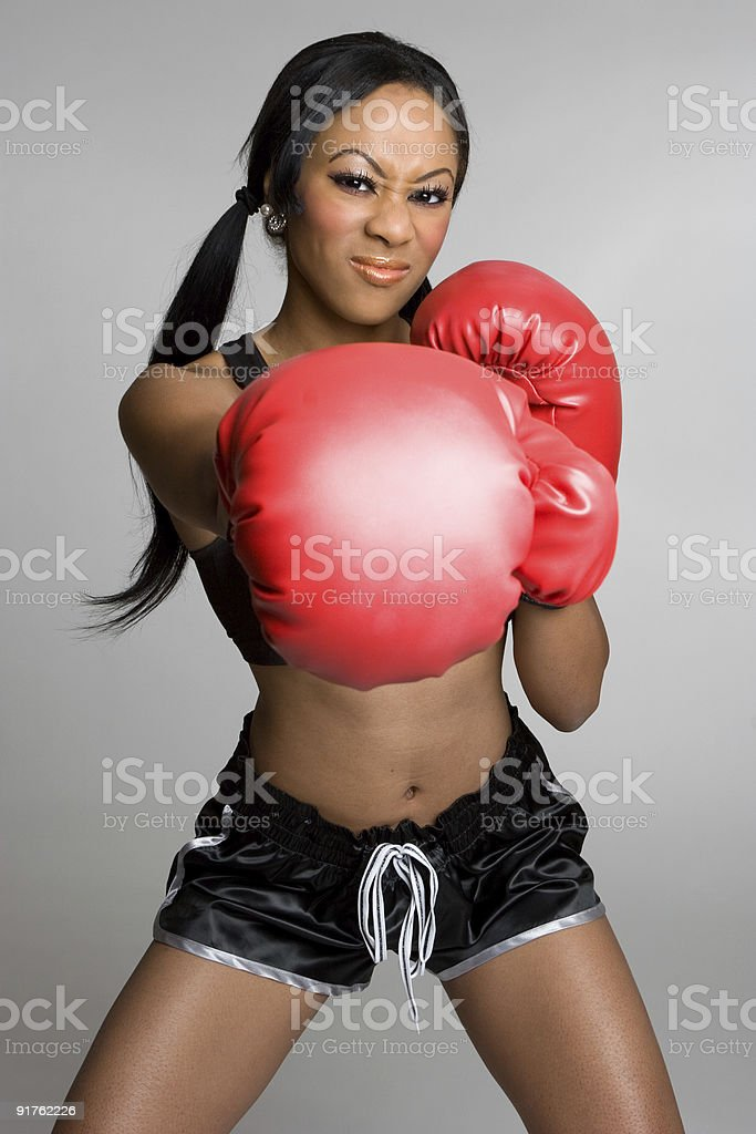 Angry young female boxer stock photo