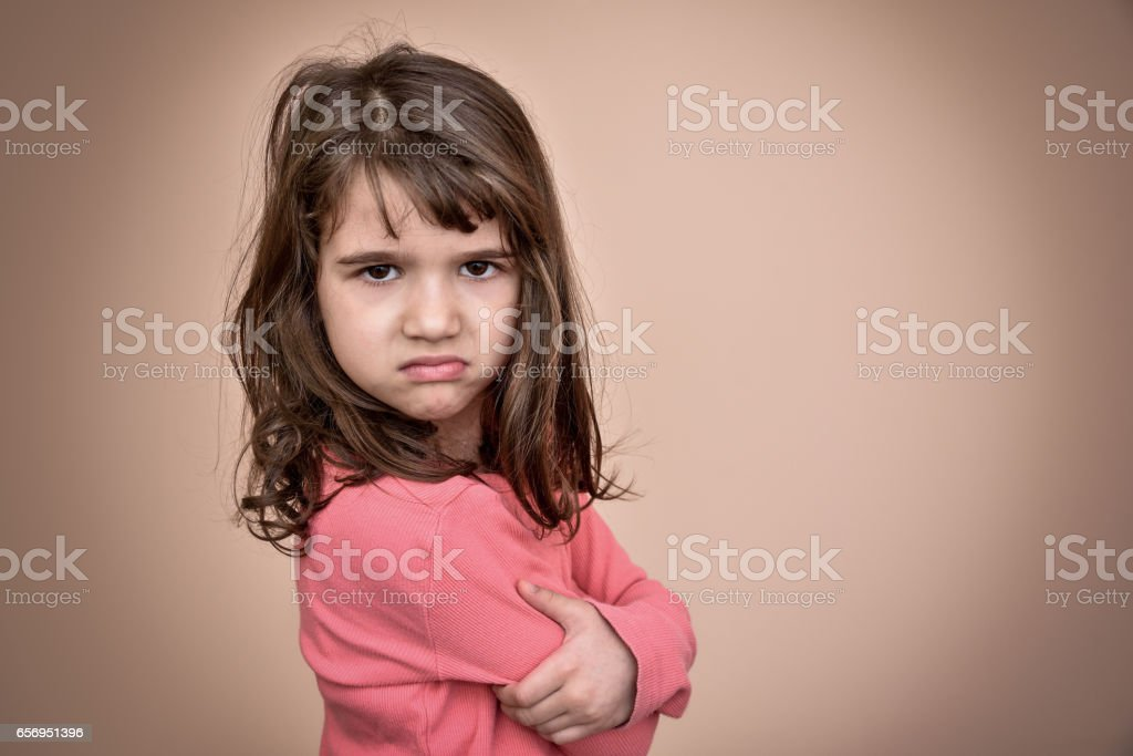 Angry young girl stock photo