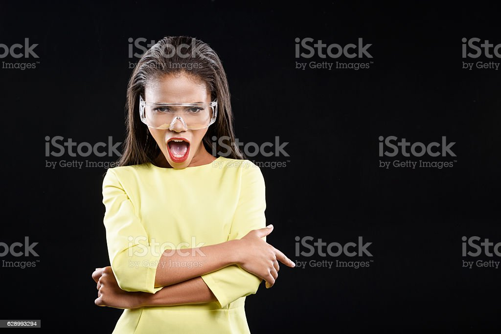 Angry young lady is crossing her arms stock photo