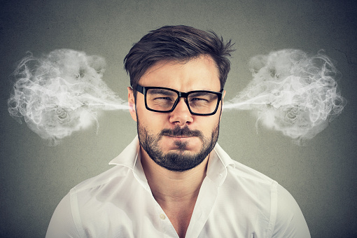 istock angry young man, blowing steam coming out of ears 1040653898