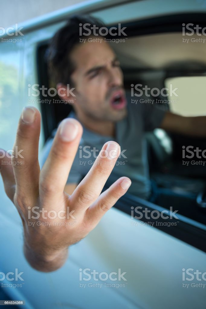 Angry young man gesturing royalty-free stock photo
