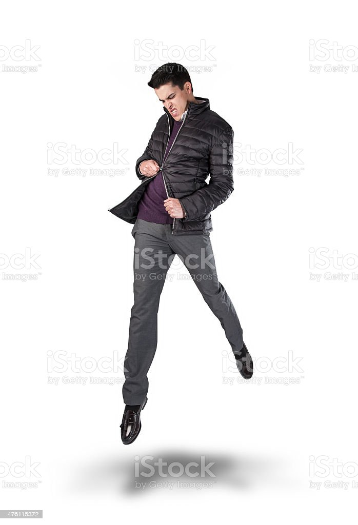Angry Young Man Jumping and Pulling at his Broken Zipper. stock photo