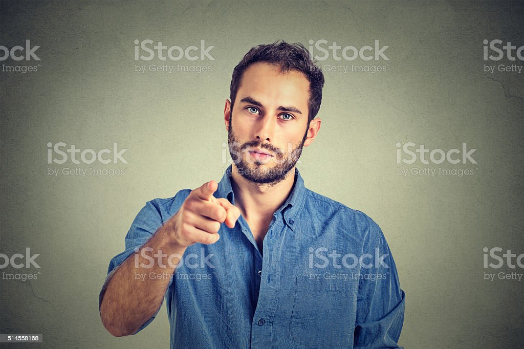 angry young man pointing finger at you camera gesture stock photo