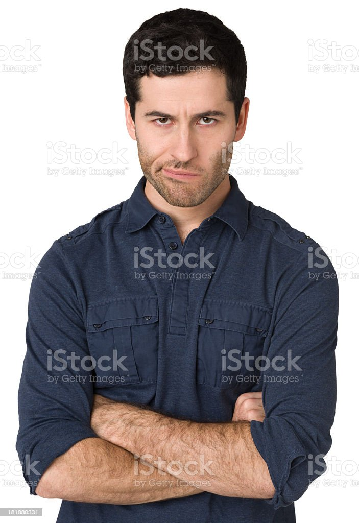 Angry Young Man, Staring At Camera, Arms Crossed stock photo