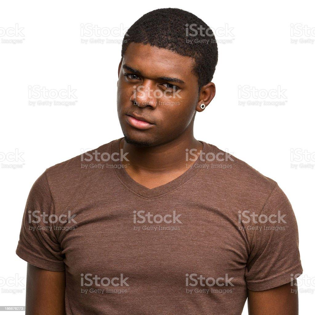 Angry Young Man Staring at Camera stock photo